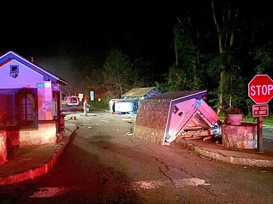 Firefighters and police responded to a report of an overturned vehicle early Saturday morning near the Taconic Parkway and FDR State Park. A booth at the park's entrance was damaged by the vehicle.