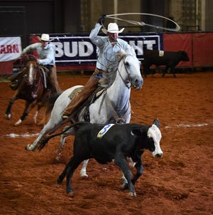 In this file photo, members of the Burns Ranch compete in 2019 in the calf doctoring event of the 39th Annual Texas Ranch Roundup at the Kay Yeager Coliseum. This year's event is canceled due to the coronavirus.