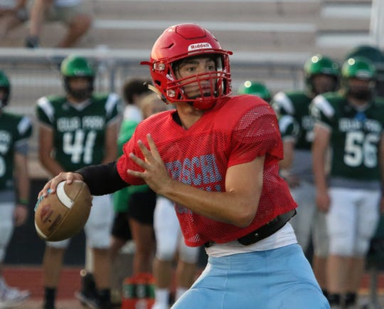 Hirschi's Tryston Randall passes in a scrimmage against Iowa Park Friday, Aug. 16, 2019, at Hawk Stadium in Iowa Park.