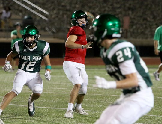 Iowa Park's Trent Green passes in a scrimmage against Hirschi Friday, Aug. 16, 2019, at Hawk Stadium in Iowa Park.