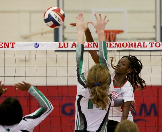 Hirschi's Niara Hightower spikes the ball against Breckenridge Saturday, Aug. 17, 2019, in the Lu Allen Memorial Tournament in Graham.