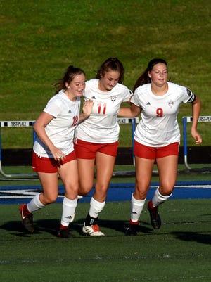 Rosecrans' Gracie Milam, left, Korynn Porter and Maggie Hutcheson celebrate a goal against Zanesville on Friday at John D. Sulsberger Memorial Stadium.