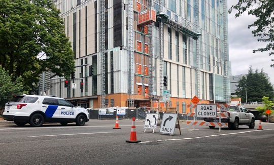 A road closure sign is seen in downtown Portland, Ore., Friday, Aug. 16, 2019, in advance of a rally as the city prepares for crowds. In the past week, authorities in Portland have arrested a half-dozen members of right-wing groups on charges related to violence at previous politically motivated rallies as the liberal city braces for potential clashes between far-right groups and self-described anti-fascists who violently oppose them.