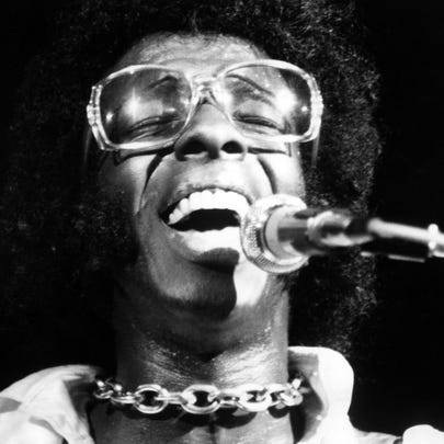 """Sly Stone of """"Sly And The Family Stone"""" performs at the Woodstock Festival on August 17, 1969, in Bethel, New York."""
