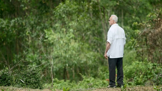 In an image provided by ESPN from video, Rocky Bleier stands in Hiep Duc Valley, about 35 miles south of Danang in Vietnam, on Aug. 20, 2018.