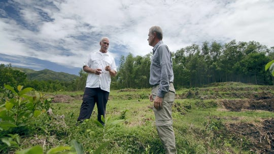 In an image provided by ESPN from video, Rocky Bleier talks with ESPN reporter Tim Rinaldi in Hiep Duc Valley, about 35 miles south of Danang in Vietnam, on Aug. 20, 2018. Three months into his deployment to Vietnam, Bleier was shot through the thigh and suffered a grenade blast to his foot.