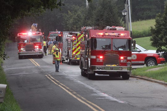 Police investigating a fire on School Rd in Marlboro Township.