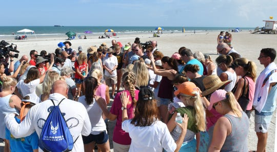 Group prayer.Stephanie Young McCluney, wife of Brian McCluney, one of two missing boaters, was joined by a group of supporters gathered at Jetty Park late Sunday afternoon to pray and search the shore for any clues in the search for the missing boaters who left Port Canaveral.