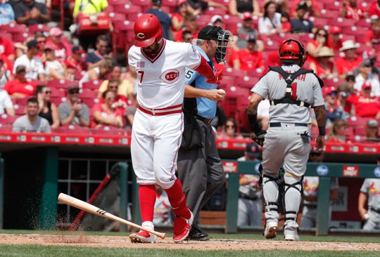Aug 18, 2019; Cincinnati, OH, USA; Cincinnati Reds third baseman Eugenio Suarez (7) throws his bat down after striking out against the St. Louis Cardinals during the fifth inning at Great American Ball Park. Mandatory Credit: David Kohl-USA TODAY Sports