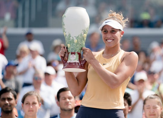 Madison Keys lifts the Rookwood Trophy after defeating Svetlana Kuznetsova 7-5, 7-6 in the Western & Southern Open tennis tournament finals match between on Sunday, Aug. 18, 2019, in Mason.