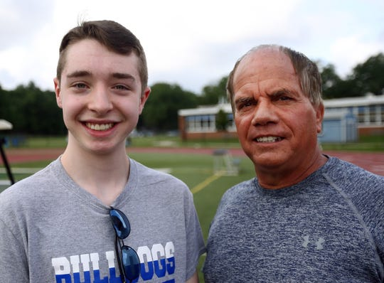 Eddie Kalegi, left, with Metuchen High School Principal Bruce Peragallo