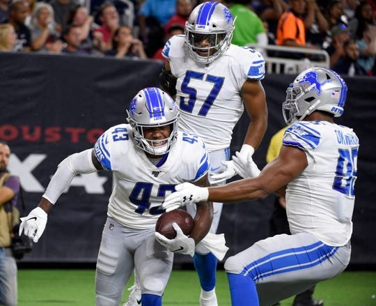 Detroit Lions' Will Harris (43) celebrates with Anthony Pittman (57) and Romeo Okwara, right, after returning a fumble for a touchdown against Houston Texans during the first half Saturday, Aug. 17, 2019, in Houston.