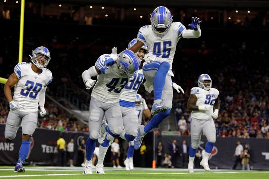 Detroit Lions' Amani Oruwariye (No. 46) congratulates Will Harris (No. 43) after Harris' touchdown in the second quarter against the Houston Texans on August 17, 2019 in Houston.