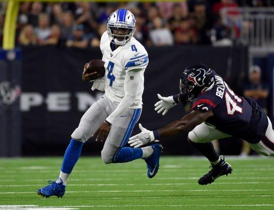 Josh Johnson avoids Texans linebacker Davin Bellamy on Aug. 17.