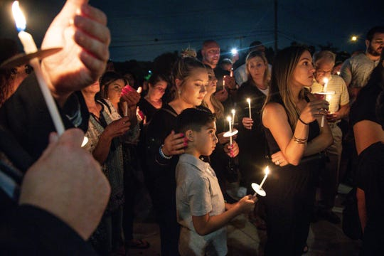 Community members attend a candle light vigil to remember Jimmy Al-Daoud at the Chaldean Community Foundation in Sterling Heights on Thursday, August 15, 2019.