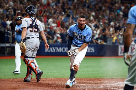 Rays shortstop Willy Adames celebrates as he scores the winning run during the ninth inning to beat the Tigers, 5-4, at Tropicana Field.