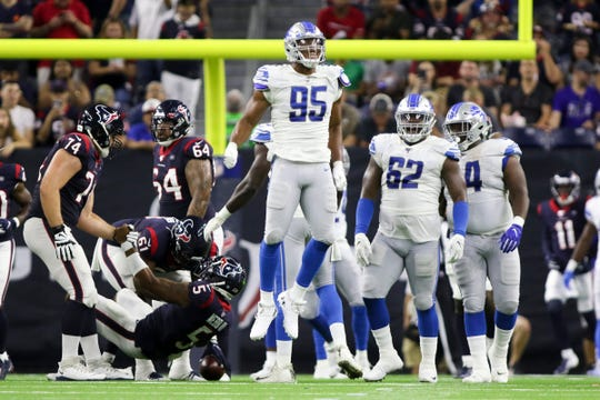 Detroit Lions defensive end Romeo Okwara (95) celebrates after sacking Houston Texans quarterback Joe Webb during the second quarter at NRG Stadium on August 17, 2019 in Houston.