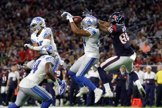 Detroit Lions' Andrew Adams intercepts a pass intended for Jester Weah of the Houston Texans in the second quarter at NRG Stadium on August 17, 2019 in Houston.