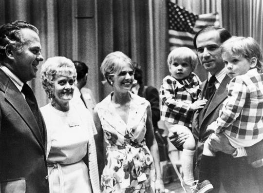 In this summer 1972 file photo, Joe Biden, carries both of his sons, Joseph, left, and Robert during an appearance at the Democratic state convention At center is his wife Neilia Biden, who was killed in an auto crash, Dec. 20, 1972. With them are Gov.-elect Sherman W. Tribbitt and his wife, Jeanne.