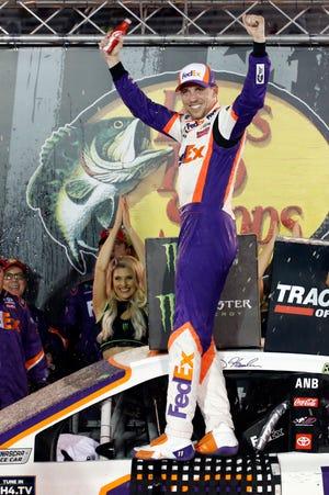 Denny Hamlin celebrates after winning the NASCAR Cup Series auto race Saturday in Bristol, Tenn.