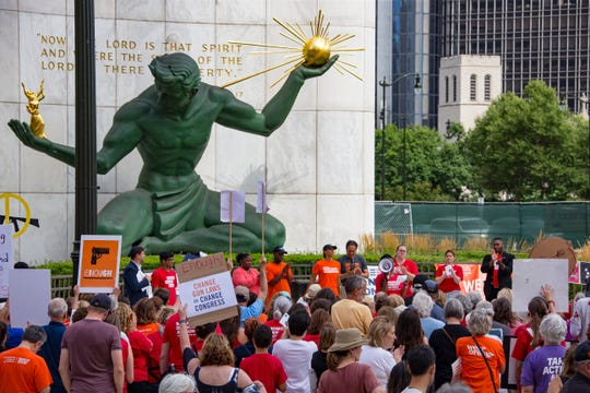 "Survivors, community leaders, and supporters of gun violence prevention hold a rally calling for the U.S. Senate to pass background checks and a ""red flag"" law on Sunday in Detroit."