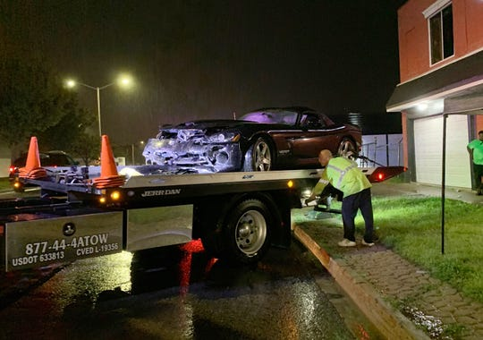 A Dodge Viper that crashed Saturday night during the Woodward Dream Cruise in Pontiac is loaded onto a tow truck to be hauled away.