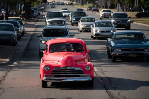 A classic Chevrolet makes its way down Woodward Avenue near Nine Mile in Ferndale during the Woodward Dream Cruise on Saturday.
