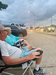Ann and Jerry Snyderman of Huntington Woods enjoy the classic cars in traffic on Saturday during the Dream Cruise.