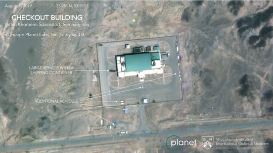 This Aug. 9 satellite image from Planet Labs Inc., that has been annotated by experts at the James Martin Center for Nonproliferation Studies at Middlebury Institute of International Studies, shows activity at the Imam Khomeini Space Center in Iran's Semnan province.