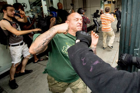 "A man tussles with protesters against right-wing demonstrators following an ""End Domestic Terrorism"" rally in Portland, Ore., on Saturday."