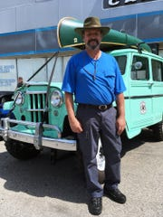 Dan Durst of Cedar Springs with his U.S. Forest Service Jeep on Saturday.