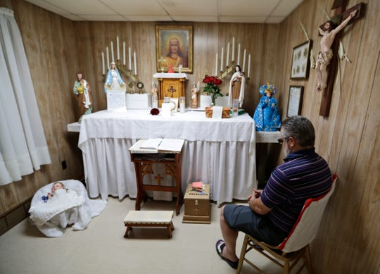 Ron Sattler sits in the chair where Rhoda Wise said that she was visited by Jesus Christ in front of the altar in Canton, Ohio.