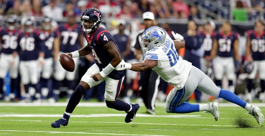 Houston Texans quarterback Deshaun Watson tries to get away from Detroit Lions defensive end Romeo Okwara during the first half.