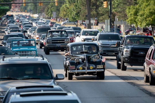 FILE - Classic and modern cars cruise down Woodward Avenue in Ferndale during the Woodward Dream Cruise.
