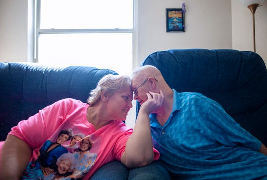 Kelly and Jimmy Wilson enjoy time together in their living room on July 31, 2019, in Janesville, Wis. Jimmy, who has Down Syndrome, married Kelly 25 years ago.