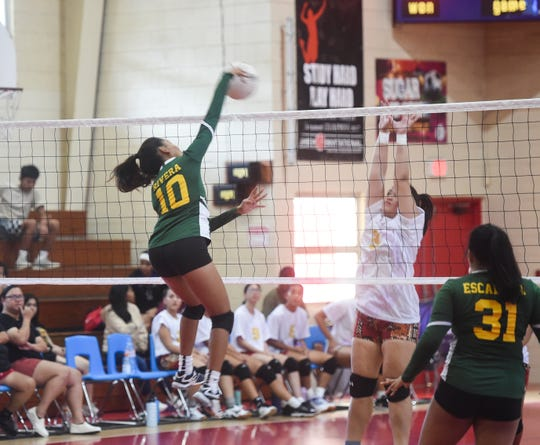 In this file photo from the 20th Annual Shieh Pre-Season Volleyball Tourney, JFK Islanders power hitter Kiana Rivera rips one straight down in the finals against the GW Geckos on Aug. 17, 2019.