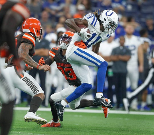 Indianapolis Colts wide receiver Deon Cain (11) jumps away from Cleveland Browns defensive back Sheldrick Redwine (33) in the second half of their preseason game at Lucas Oil Stadium on Saturday, August 17, 2019. The Colts lost to the Browns 21-18.