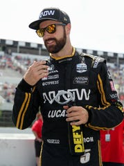 Aug 18, 2019; Long Pond, PA, USA; Indycar driver James Hinchcliffe stands on pit road prior to the ABC Supply 500 at Pocono Raceway.