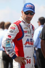 Aug 18, 2019; Long Pond, PA, USA; Indycar driver Tony Kanaan stands on pit road prior to the ABC Supply 500 at Pocono Raceway.