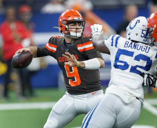 Cleveland Browns quarterback David Blough (9) passes on the Colts defense in the second half of their preseason game at Lucas Oil Stadium on Saturday, August 17, 2019. The Colts lost to the Browns 21-18.