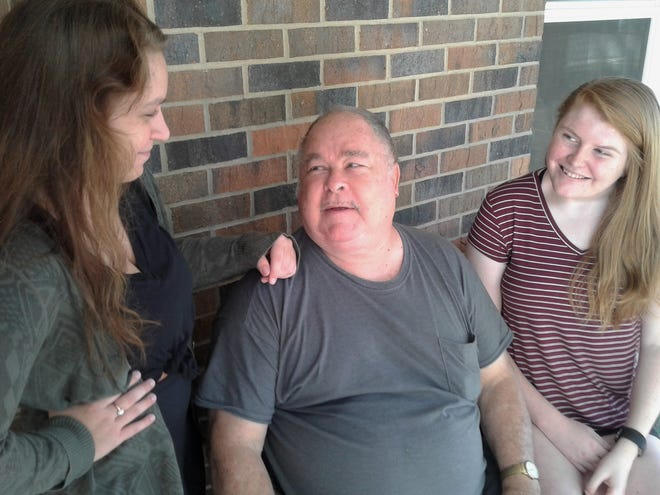 Solon Senior Support organizers Tori Jones (left) and Jenna Runge chat with Bob Louvar on his front porch. Louvar is among about 20 Solon seniors now being assisted with chores by this new organization.