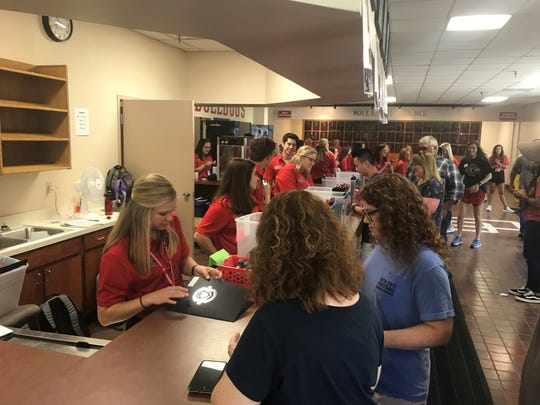 New students picked up initial items of move-in day in the lobby of Fred DeLay Gymnasium at Union University on Friday.