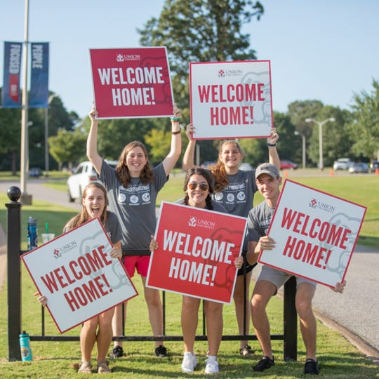 "New students moving into dorms at Union University were met with ""Welcome Home"" signs as they entered campus on Friday."