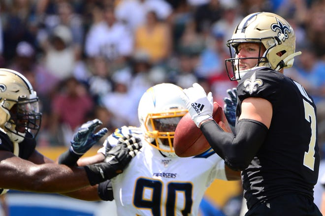 Aug 18, 2019; Carson, CA, USA; New Orleans Saints quarterback Taysom Hill (7) looks to pass during the second quarter against the Los Angeles Chargers at Dignity Health Sports Park. Mandatory Credit: Jake Roth-USA TODAY Sports