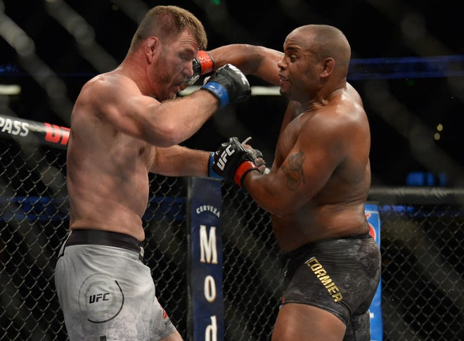 Daniel Cormier lands a hit against Stipe Miocic during UFC 241 on Saturday at Honda Center in Anaheim, California.