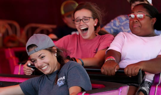 Fair attendees enjoy a ride on the Midway at the Kentucky State Fair on Friday.