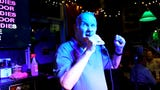Crunchy's karaoke star Dennis Foreback, 72, sings Drowning Pool's hit nu-metal song 'Bodies' recently in East Lansing. Foreback performs three times a week.