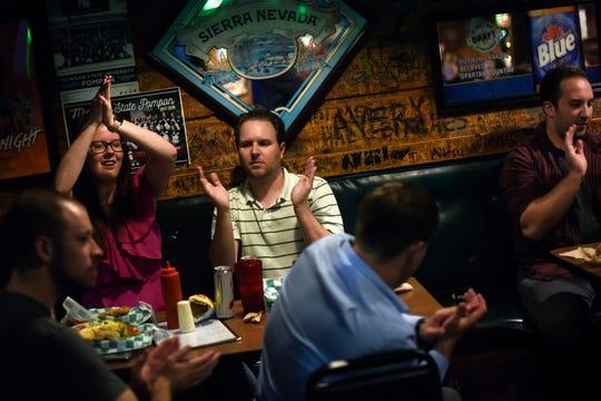 Dennis Foreback fans cheer during one of Dennis' karaoke performances at Crunchy's on Thursday, Aug. 15, 2019, in East Lansing.