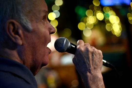 """Dennis Foreback sings """"New York, New York"""" during karaoke night at Crunchy's on Thursday, Aug. 15, 2019, in East Lansing. Foreback has been singing karaoke since 1993. He goes to Crunchy's three times a week to perform."""