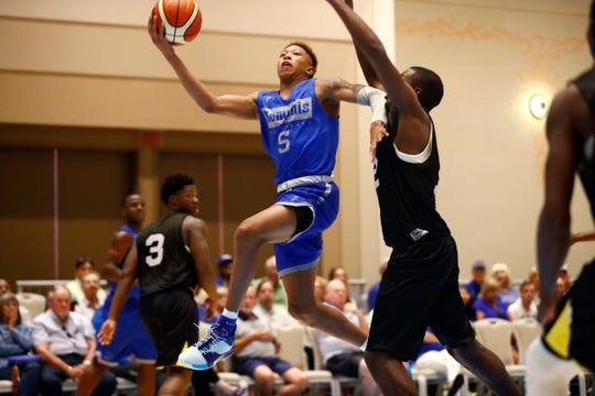 Memphis Tigers guard Boogie Ellis lays the ball up against Raw Talent Elite during their exhibition game at the Grand Hyatt Baha Mar's New Providence Ballroom on Sunday, August 18, 2019.